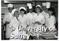 Photograph of students in the Hotel and Catering Department at the University of Surrey preparing food in a kitchen