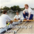 Photograph of members of the University of Surrey Boat Club rowing on a river